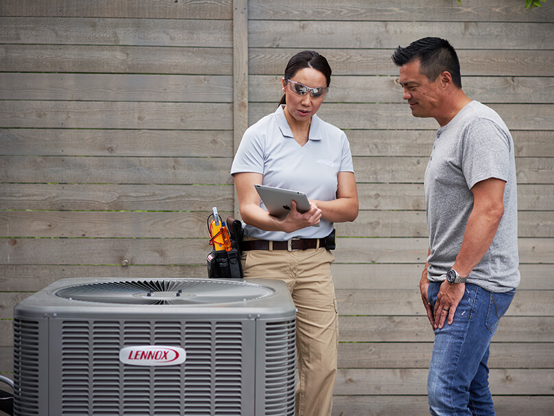 Woman looking at an air conditioning unit